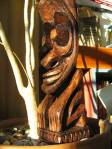 a Tiki carving with protruding eyes