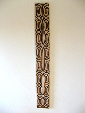 a relief carving with spiral designs